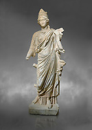 Roman statue of Tyche. Marble. Perge. 2nd century AD. Inv no . Antalya Archaeology Museum; Turkey.  Against a grey background<br /> <br /> Tyche was the presiding tutelary deity who governed the fortune and prosperity of a city, its destiny. In Classical Greek mythology, she is the daughter of Aphrodite and Zeus or Hermes. .<br /> <br /> If you prefer to buy from our ALAMY STOCK LIBRARY page at https://www.alamy.com/portfolio/paul-williams-funkystock/greco-roman-sculptures.html . Type -    Antalya     - into LOWER SEARCH WITHIN GALLERY box - Refine search by adding a subject, place, background colour, museum etc.<br /> <br /> Visit our ROMAN WORLD PHOTO COLLECTIONS for more photos to download or buy as wall art prints https://funkystock.photoshelter.com/gallery-collection/The-Romans-Art-Artefacts-Antiquities-Historic-Sites-Pictures-Images/C0000r2uLJJo9_s0