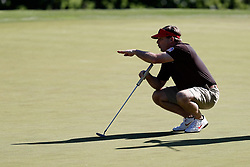 Kirby Smart lines up a putt during the Chick-fil-A Peach Bowl Challenge at the Oconee Golf Course at Reynolds Plantation, Sunday, May 1, 2018, in Greensboro, Georgia. (Paul Abell via Abell Images for Chick-fil-A Peach Bowl Challenge)