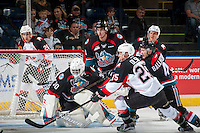 KELOWNA, CANADA - SEPTEMBER 28: Michael Herringer #30 of Kelowna Rockets deflects a shot on net by Tate Olson #25 of Prince George Cougars on September 28, 2016 at Prospera Place in Kelowna, British Columbia, Canada.  (Photo by Marissa Baecker/Shoot the Breeze)  *** Local Caption *** Tate Olson; Michael Herringer; Gordie Ballhorn; Cal Foote;