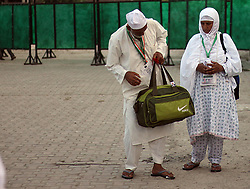 July 25, 2017 - Srinagar, India - Kashmiri Hajj pilgrims are seen ahead of departure to Mecca from Srinagar for making a pilgrimage on July, 25, 2017. The first batch of 840 Kashmiri Hajj set off for the annual pilgrimage to the holiest place for Muslims to perform this year's ritual. (Credit Image: © Faisal Khan/Pacific Press via ZUMA Wire)