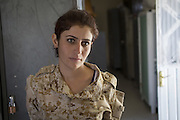 Sulaymaniyah, Iraq - <br /> <br /> Female Fighters of The Peshmerga<br /> As ISIS has swept across northern Iraq, they have become known for their atrocities towards women. However, there's a group of women that aren't preparing to flee ISIS but instead are preparing to meet them with their AK-47s. The 2nd Peshmerga, are a battalion of Kurdish fighters 'Äì and they just happen to be an all-female soldiers. They're front line troops, some of whom have been fighting for years, and they are eager to face ISIS. Dressed in army fatigues and armed with rifles, they are ready to lay down their lives to protect the Kurdish homeland against the threat of ISIS. They carry out training exercises and look no different from other Kurdish soldiers - except for a hint of makeup on some faces and long hair escaping from their caps. The 2nd Battalion consists of 550 mothers, sisters and daughters and was formed in 1996. Over the past month, they have moved into disputed areas abandoned by Iraqi security forces during the Isis advance. They have also recently seized control of oil production facilities at Bai Hassan and Kirkuk - the female Peshmerga will now be part of a mission to secure the city and its surrounding oil fields.<br /> <br /> A woman Peshmerga in her living quarters after a military exercise<br /> ©Excluisvepix Media