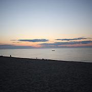 A view of the sunset from Galley Beach beachside restaurant, Nantucket,  Nantucket Island, Massachusetts, USA. Photo Tim Clayton