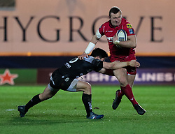 Scarlets' Hadleigh Parkes is tackled by Toulon's Anthony Belleau<br /> <br /> Photographer Simon King/Replay Images<br /> <br /> European Rugby Champions Cup Round 6 - Scarlets v Toulon - Saturday 20th January 2018 - Parc Y Scarlets - Llanelli<br /> <br /> World Copyright © Replay Images . All rights reserved. info@replayimages.co.uk - http://replayimages.co.uk