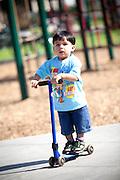 Child Riding a Razor at George Washington Park in Anaheim