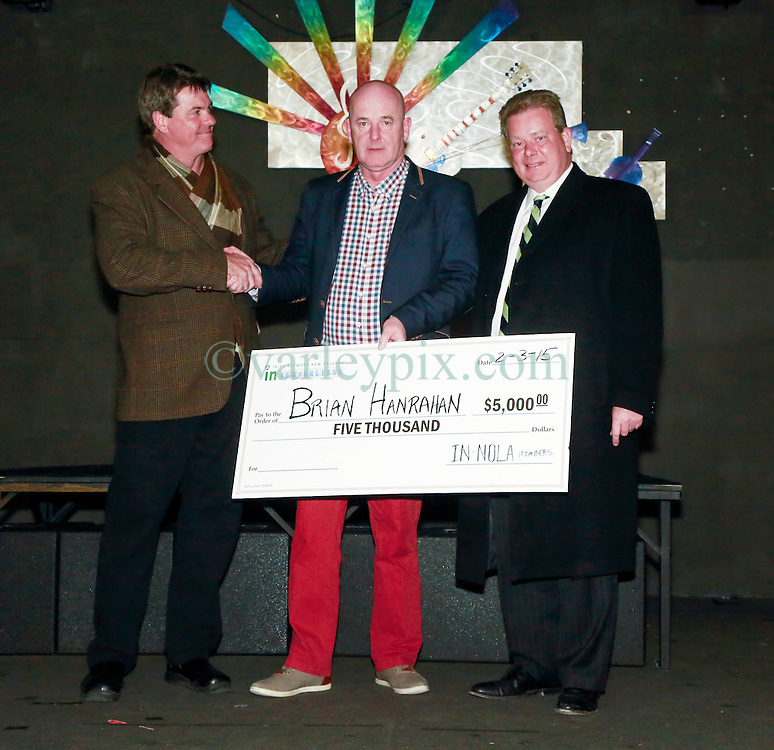 07 February 2015. New Orleans, Louisiana.<br /> Irish Network New Orleans (IN-NOLA) presents a cheque for $5,000 to Brian Hanrahan, father of Irish Garda Brian Hanrahan who was shot in New Orleans on January 27th, 2015.<br /> L/R; Rick Graham (Teasurer IN-NOLA), Brian Hanrahan and Adrian D'Arcy (President In-NOLA).<br /> Photo; Charlie Varley/varleypix.com