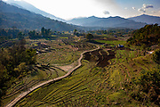 A road along the terraced farmland on the hills outside Paudi, on the 6th of March 2020 in Paudi, Sundarbazar, Lamjung District, Gandaki Pradesh, Nepal.