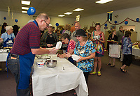 Ed Harrington with Marilyn Lezberg on the griddle serving up approximately 1400 cheese blintzes to patrons at the Jewish Food Festival at Temple B'nai Isreal on Sunday.   (Karen Bobotas/for the Laconia Daily Sun)