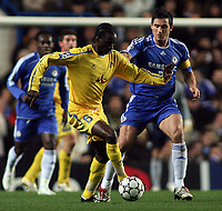 Photo: Paul Thomas.<br /> Chelsea v Levski Sofia. UEFA Champions League, Group A. 05/12/2006. <br /> <br /> Frank Lampard of Chelsea (R) challenges Richard Eromoigbe