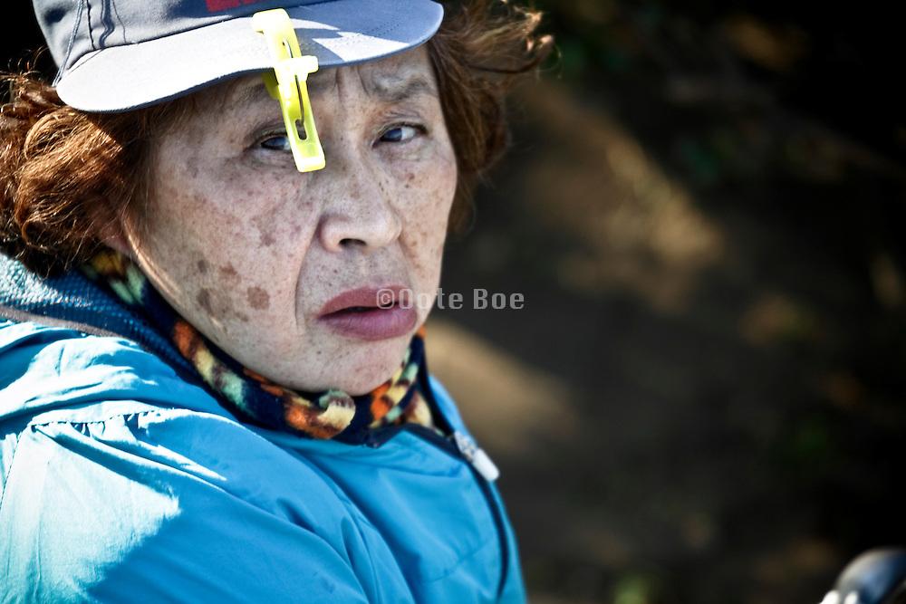 elderly Japanese woman looking