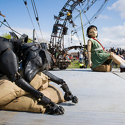 LIVERPOOL, UK, 20th April, 2012. The Sea Odyssey. The little girl giant and her dog take an afternoon nap.