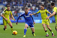 Cardiff City's Aron Gunnarsson (c) takes on Rotherham's Richard Smallwood (l) and Jon Taylor (r). EFL Skybet championship match, Cardiff city v Rotherham Utd at the Cardiff city stadium in Cardiff, South Wales on Saturday 18th February 2017.<br /> pic by Carl Robertson, Andrew Orchard sports photography.