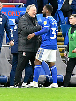 Football - 2020 / 2021 Sky Bet Championship - Cardiff City vs Middlesbrough - Cardiff City Stadium<br /> <br /> Middlesborough manager Neil Warnock on his return to Cardiff City greets Junior Hoilett of Cardiff City with a fist bump & smile  at end of match<br /> in a match played without fans<br /> <br /> COLORSPORT
