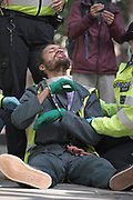 """Protester gets arrested at the """"Climate Justice is Migrant Justice"""", outside Home Office, Marsham Street in central London on Friday, Sept 4, 2020. (VXP Photo/ Gio Strondl)"""