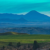 The Bears Paw Mountains rise above coulees and dry-land farms of the Upper Missouri River Breaks in north central Montana.