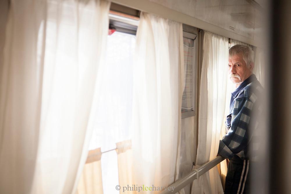 Passenger on the BAM (Baikal-Amur Mainline) Railway line. Siberia, Russia