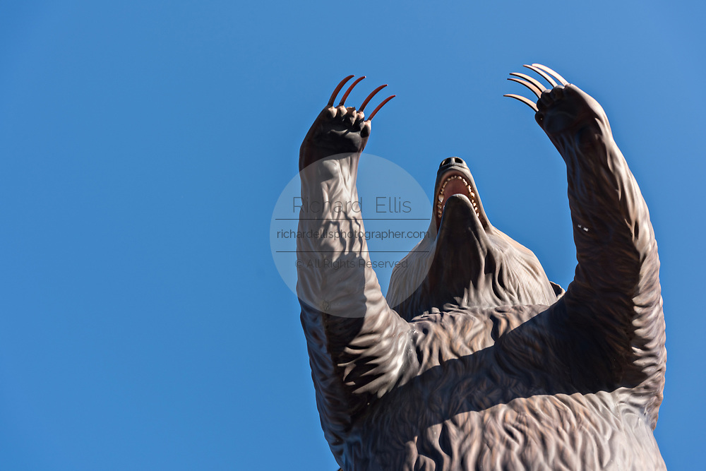 A grizzly bear statue to attract tourists at a shop along 4th Avenue in downtown Anchorage, Alaska.