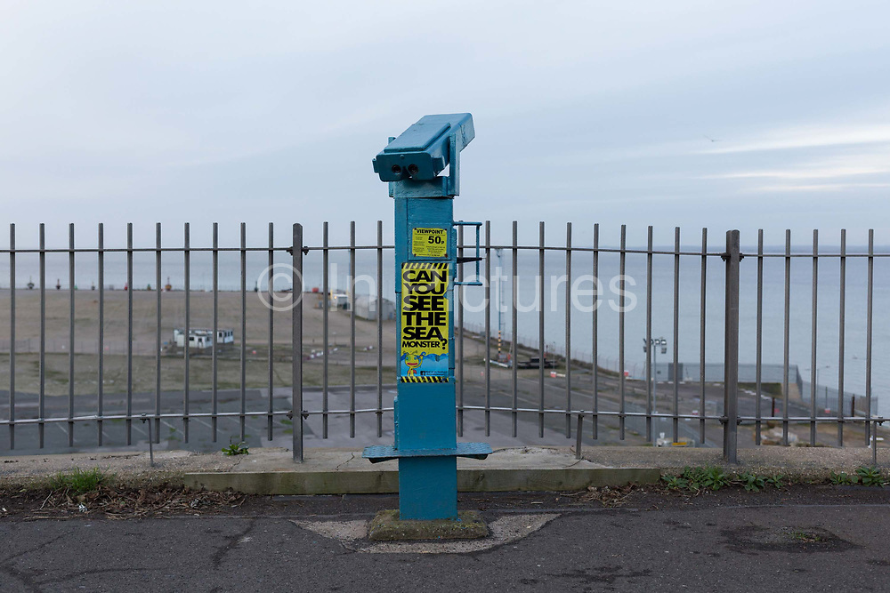 Sea view telescope on West Cliff Promenade that overlooks the Port of Ramsgate, on 8th January 2019, in Ramsgate, Kent, England. The Port of Ramsgate has been identified as a Brexit Port by the government of Prime Minister Theresa May, currently negotiating the UKs exit from the EU. Britains Department of Transport has awarded to an unproven shipping company, Seaborne Freight, to provide run roll-on roll-off ferry services to the road haulage industry between Ostend and the Kent port - in the event of more likely No Deal Brexit. In the EU referendum of 2016, people in Kent voted strongly in favour of leaving the European Union with 59% voting to leave and 41% to remain.