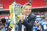 AFC Wimbledon Manager Neal Ardley with the trophy after AFC Wimbledon seal promotion to League One, after beating Plymouth Argyle Football Club 2-0 during the Sky Bet League 2 play off final match between AFC Wimbledon and Plymouth Argyle at Wembley Stadium, London, England on 30 May 2016. Photo by Stuart Butcher.