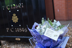 © Licensed to London News Pictures . 18/09/2013 . Hyde , UK . Flowers and tributes in memory of PCs Fiona Bone and Nicola Hughes at a memorial garden at Hyde police station this morning (18th September 2013) . The two PCs were on duty one year ago today (18th September 2012) , when they were murdered by Dale Cregan , whilst responding to a fake 999 call that he'd placed . A private family memorial event is due to take place at the gardens later this morning (18th September 2013) at 10:53 , at the time to two were murdered . Photo credit : Joel Goodman/LNP