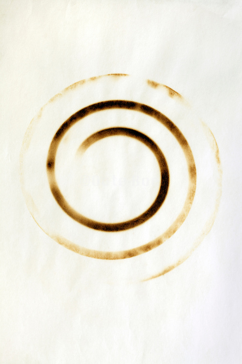 blank sheet of paper burned with a circular imprint