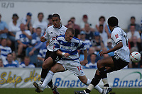 Fotball<br /> Foto: SBI/Digitalsport<br /> NORWAY ONLY<br /> <br /> Coca-Cola Championship<br /> <br /> QPR / Queens Park Rangers v Derby County<br /> <br /> 21/08/2004<br /> <br /> Martin Rowlands QPR looses out to the Derby defence.