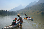 With the Tetons fading into the smoke from distant wildfires, Mona Sobieski gets a hand from Greg Meyers at the Teton Adaptive Sports and Rendezvous River Sports' demo day at String Lake on Sunday afternoon.
