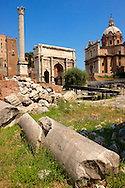 fallen columns looking towards the Arch of Septimius Severus, The Forum Rome .<br /> <br /> Visit our ITALY HISTORIC PLACES PHOTO COLLECTION for more   photos of Italy to download or buy as prints https://funkystock.photoshelter.com/gallery-collection/2b-Pictures-Images-of-Italy-Photos-of-Italian-Historic-Landmark-Sites/C0000qxA2zGFjd_k<br /> .<br /> <br /> Visit our ROMAN ART & HISTORIC SITES PHOTO COLLECTIONS for more photos to download or buy as wall art prints https://funkystock.photoshelter.com/gallery-collection/The-Romans-Art-Artefacts-Antiquities-Historic-Sites-Pictures-Images/C0000r2uLJJo9_s0