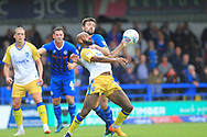 Joe Rafferty challenges Josh Parker during the EFL Sky Bet League 1 match between Rochdale and Gillingham at Spotland, Rochdale, England on 15 September 2018.