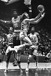 Golden State Warriors Jim Barnett scores against the Atlanta Hawks Bob Christian....(1972 photo/Ron Riesterer)