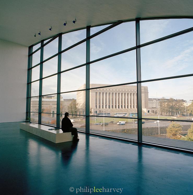 Man sitting by the window in Helsinki's museum of modern art