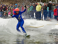 """Electric Blue"" Shaun Dever of Meredith skims the pond during the Bring Your Own Dry Clothes race Sunday afternoon at Gunstock Mountain to celebrate their final day of the season.  (Karen Bobotas/for the Laconia Daily Sun)"
