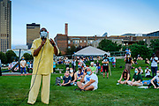 21 JULY 2020 - DES MOINES, IOWA: Iowa State Representative AKO ABDUL-SAMAD eulogizes Representative John Lewis (D-GA) during a memorial and vigil for the Congressman. About 300 people attended the vigil for the late Congressman Lewis in Poppajohn Sculpture Park in Des Moines Tuesday night. Rep. Lewis died from pancreatic cancer on July 17, 2020.               PHOTO BY JACK KURTZ