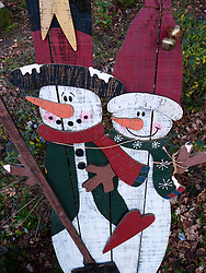 Decorative painted wooden snowmen for sale in German shop