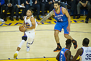 Oklahoma City Thunder center Steven Adams (12) grabs Golden State Warriors guard Stephen Curry (30) after he dribbles past him at Oracle Arena in Oakland, Calif., on November 3, 2016. (Stan Olszewski/Special to S.F. Examiner)
