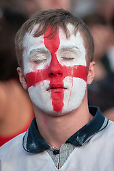 © Licensed to London News Pictures . 11/07/2018. Manchester, UK. An England fan cries as the final whistle blows and England are defeated in the World Cup. England fans watch England play against Croatia in the World Cup semi finals, on a big screen at Castlefield Bowl in Manchester City Centre . Until today , Manchester had been the largest city in England not to be showing World Cup matches to the public on a big screen . Photo credit: Joel Goodman/LNP