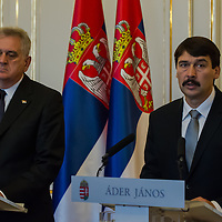 Tomislav Nikolic (L) president of Serbia and his Hungarian counterpart Janos Ader (R) talk on a press conference during their meeting in Budapest, Hungary on November 13, 2012. ATTILA VOLGYI