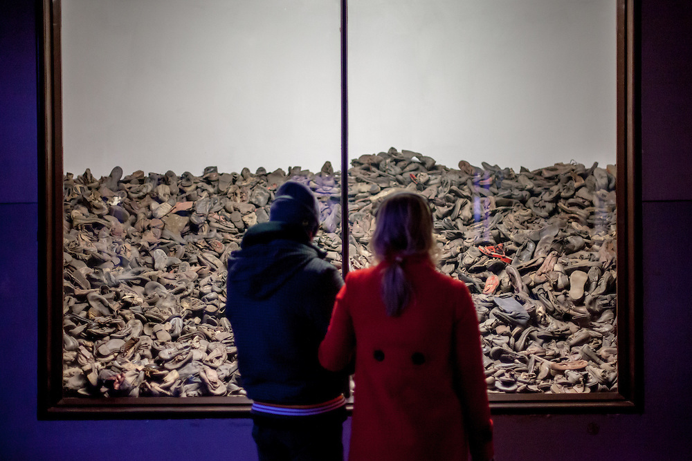 """Visitors at the general exhibition at Block 5 in the Auschwitz Nazi concentration camp showing """"evidence of a war crime"""" with belongings of prisoners such as shoes, glasses and suitcases. It is estimated that between 1.1 and 1.5 million Jews, Poles, Roma and others were killed in Auschwitz during the Holocaust in between 1940-1945."""