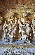 """Early Anglo Saxon sulptures of the Apostles now part of the south porch of Malmesbury Abbey, Wiltshire, England. The apostles, apart from Peter who holds a crude key, have no distinguishing feature to allow identification. Some are holding books, none have halos and some hold their heads at awkward angles. These three styles are typical of Anglo Saxon art. The two panels are 10 ft long and 4ft 6"""" high are date from the original Ango Saxon church of 705. They were probablbly built into the proch during the Norman rebuilding. The style of these sculptures is of the Roman Byzantine style and were probably sculpted by masions from Gaul.  Malmesbury Abbey, Wiltshire, England .<br /> <br /> Visit our MEDIEVAL PHOTO COLLECTIONS for more   photos  to download or buy as prints https://funkystock.photoshelter.com/gallery-collection/Medieval-Middle-Ages-Historic-Places-Arcaeological-Sites-Pictures-Images-of/C0000B5ZA54_WD0s"""