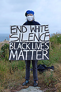 Climate change activists from Extinction Rebellion standing in solidarity with the world wide protest, Black Lives Matter following the death of George Floyd in the USA in their weekly protest called No Going Back which is usually linked to climate change and has now grown to become a national event, on Sunday at 10.00am on the 7th June 2020 in St Ives, United Kingdom. Black Lives Matter is an international human rights movement, originating from within the African-American community which campaigns against violence and systemic racism towards black people. Around 40 members of the St Ives community decided to protest by standing for an hour holding placards with slogans such as 'Black Lives Matter' and 'I can't breathe'.