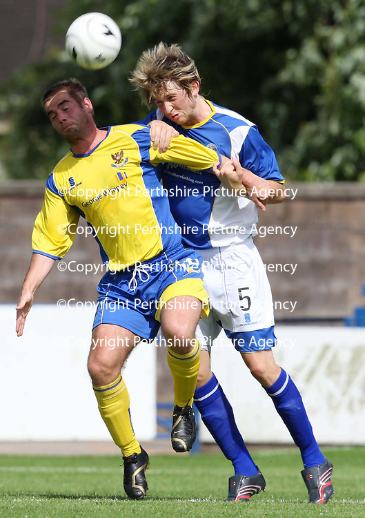 Queen of the South v St Johnstone...04.08.07<br /> Peter MacDonald is tackled by trialist Liam Aitken<br /> <br /> Picture by Graeme Hart.<br /> Copyright Perthshire Picture Agency<br /> Tel: 01738 623350  Mobile: 07990 594431