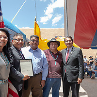 Harrison Dehiya, second from right, was awarded by Second Lady Dottie Lizer, far left, Vice President Myron Lizer, second from left, Council Delegate Edmund Yazzie, center,  and President Jonathan Nez during a day of celebration at Ellis Tanner Trading Company Saturday.