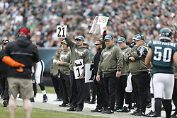 Philadelphia Eagles Sports Science Coordinator Shaun Huls and a coach hold up signs on the sideline during the NFL game between the Philadelphia Eagles and the Washington Redskins on Sunday, November 17th 2013 in Philadelphia. The Eagles won 24-16. (AP Photo/Brian Garfinkel)