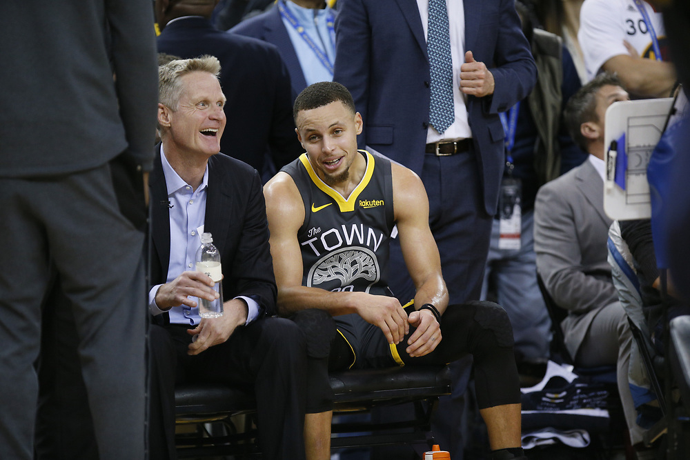 Golden State Warriors head coach Steve Kerr with Golden State Warriors guard Stephen Curry (30) in the second half of an NBA game at Oracle Arena on Saturday, Feb. 2, 2019, in Oakland, Calif. The Warriors won 115-101.