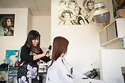 Hue Luu cuts a customer's hair at Tina's Hair Design in Milpitas, California, on September 11, 2014. (Stan Olszewski/SOSKIphoto)
