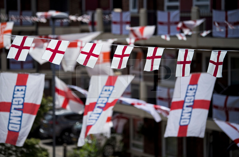 © Licensed to London News Pictures. 12/06/2021. London, UK. The Kirby Estate in south London blanketed in Saint George's Cross, the national flag of England, ahead of England's opening fixture in the 2020 UEFA European Football Championship tomorrow. Photo credit: Ben Cawthra/LNP