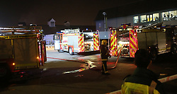 Port Solent,Hampshire Saturday 13th March 2016 A fire has broken out at the Casa Brasil restaurant  in Port Solent currently  six fire appliances from around the Hampshire area are at the scene after a fire broke out and spread to  the roof of the popular eatery.<br /> <br /> The fire  broke out in a kitchen area where staff prepare and cook meat just after 10pm this evening. It's believed that  the fire  then spread to the ventilation ducting.This is  still under investigation.<br /> <br /> Firefighters  from Southsea, Cosham, Portchester , Fareham  and Eastleigh were mobilised  to tackle the fire in Broadwalk Port Solent.<br /> <br /> An  Aerial ladder from Southsea was also sent to the incident to tackle the fire from above that had spread to the roof area of the restaurant.<br /> Police and emergency evacuated the area and set up cordons moving the crowds of people away from the area. At the height of the incident  forty fire fighters and officers dealt with the blaze.<br /> Some customers using the complex have had to leave their vehicles on site over night . No one is believed to be hurt and all the staff from the eatery are accounted for.<br /> Jim Clarke from Hampshire Fire and Rescue said that the damage to the  property was contained to the ventilation ducts and part of the roof had also been damaged by fire. There is also water damage to the property. He went on to say  Fire crews  would  remain on site for a few more hours whilst  crews  cut away at the roof area to remove any hot spots.©UKNIP
