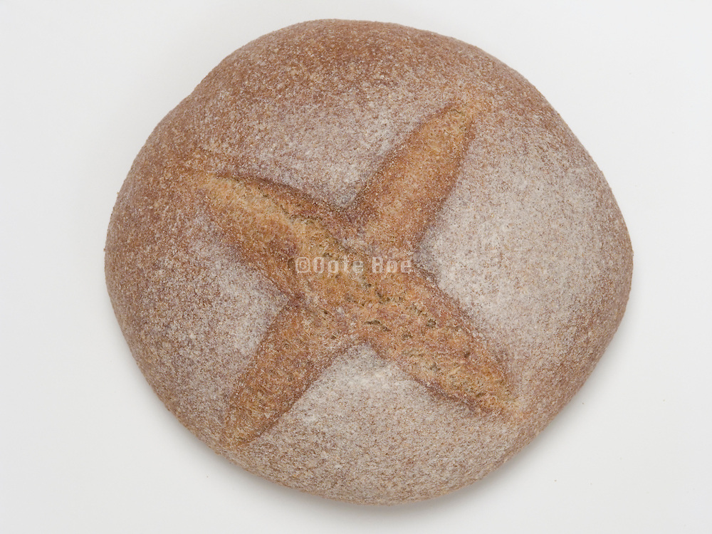 Overhead view of an organic sour dough whole wheat bread.