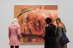 "© Licensed to London News Pictures. 26/02/2018. LONDON, UK. Visitors view ""Reverse"", 2002-3, by Jenny Saville. Preview of ""All Too Human"", an exhibition at Tate Britain which explores how artists in Britain have stretched the possibilities of paint in order to capture life around them.  The exhibition runs 28 February to 27 August 2018 and includes rarely seen works by Lucian Freud and Francis Bacon.  Photo credit: Stephen Chung/LNP"