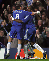 Photo: Paul Thomas.<br /> Chelsea v Valencia. UEFA Champions League. Quarter Final, 1st Leg. 04/04/2007.<br /> <br /> Didier Drogba (11) of Chelsea celebrates his goal with team-mates Frank Lampard (L) and Ashley Cole.
