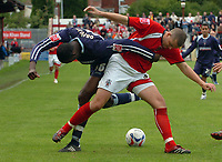 Photo: Paul Greenwood. <br />Accrington Stanley v Swindon Town. Coca Cola League 2. 07/10/2006.<br />Swindon's Fola Onibuje (L) battles with Michael Welch.